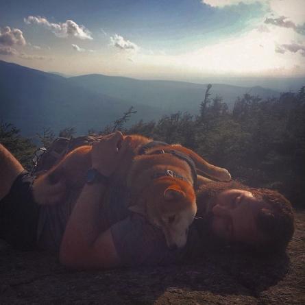 Kyle Rohrig and his dog, Katana on Mt. Kinsman in New Hampshire.